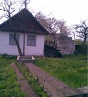 Продам дерев'яний будинок (старенький)   Житомирська обл. м. Баранівка